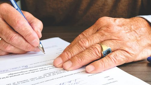 Picture of a person signing a document